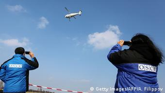 OSCE monitors watch a Camcopter test flight over Donetsk