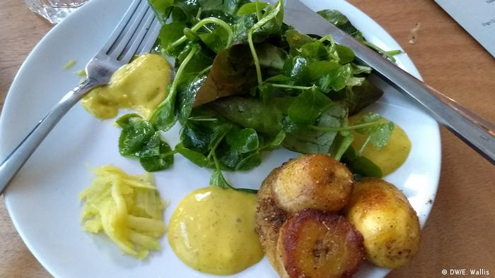 Fried plantain and mango sauce with watercress at Arawelo Eats