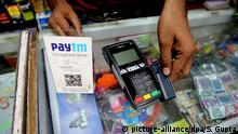 epa05646558 An Indian shopkeeper receives payment by credit card a at stationery shop in Bhopal, India, 25 November 2016. Indian business is reportedly affected due to lack of Indian currency notes. Indian Prime Minister Narendra Modi announced the elimination of the 500 and 1,000 rupee bills at midnight on 08 November, for the purpose of fighting against 'black money' (hidden assets) and corruption in the country. The decision sparked protests, while storekeepers complained about dwindling sales because many citizens lack the cash to buy the most basic products, as queues get longer at ATMs and banks. EPA/SANJEEV GUPTA +++(c) dpa - Bildfunk+++ |