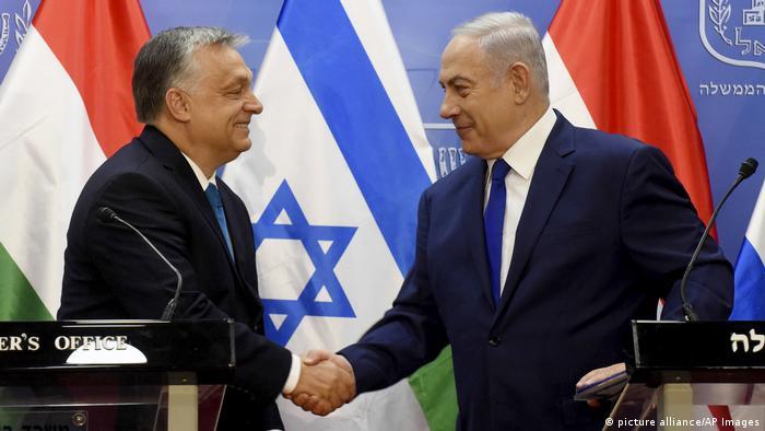 Hungarian Prime Minister Viktor Orban shakes hands with Israeli Prime Minister Benjamin Netanyahu