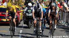 Cycling - Tour de France - The 175.5-km Stage 12 from Bourg-Saint-Maurice Les Arcs to Alpe d'Huez - July 19, 2018 - Team Sky riders Geraint Thomas of Britain, wearing the overall leader's yellowjersey, and Chris Froome of Britain with AG2R La Mondiale rider Romain Bardet of France on Alpe d'Huez. REUTERS/Stephane Mahe