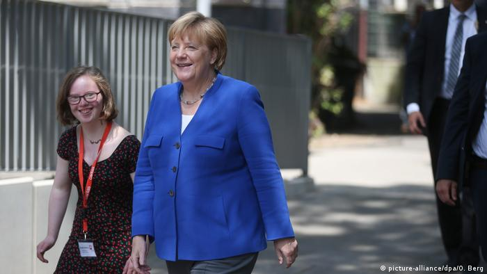 Natalie Dedreux and German chancellor Angela Merkel in 2018.