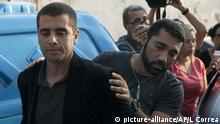 Doctor Denis Cesar Barros Furtado was escorted to a police station after his arrest (picture-alliance/AP/L Correa)