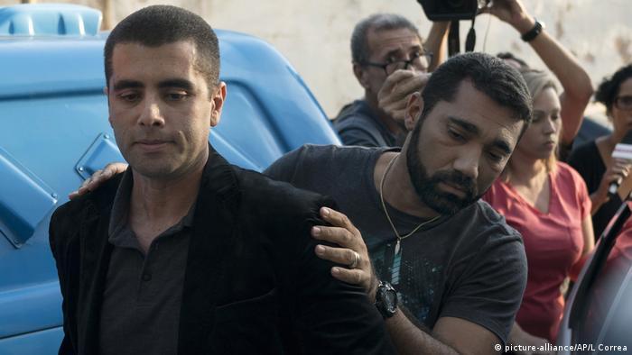 Doctor Denis Cesar Barros Furtado was escorted to a police station after his arrest
