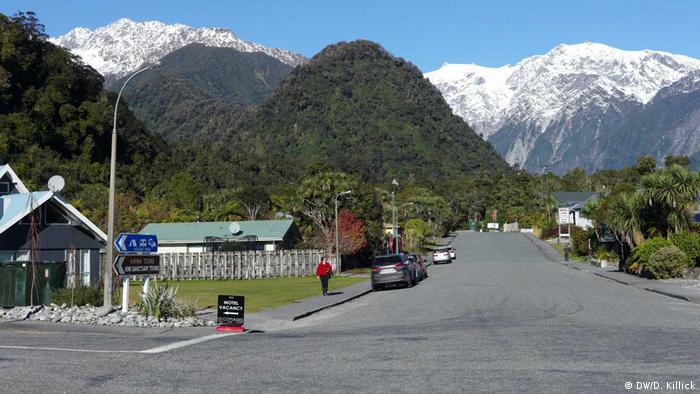 Franz Josef village in New Zealand with snow-capped mountains in the background