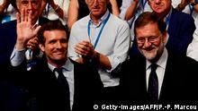 21.07.2018 +++ Spanish lawmaker Pablo Casado (L) celebrates after winning a Popular Party (PP) election to succeed former Spanish prime minister and outgoing PP leader Mariano Rajoy (R) at the end of a meeting to elect the conservative party's next leader in Madrid on July 21, 2018. - Soraya Saenz de Santamaria, 47, who for six-and-a-half years was deputy prime minister, lost to Casado, a lawmaker who has promised hope with a generational revamp of the party and a step further to the political right. (Photo by PIERRE-PHILIPPE MARCOU / AFP) (Photo credit should read PIERRE-PHILIPPE MARCOU/AFP/Getty Images)