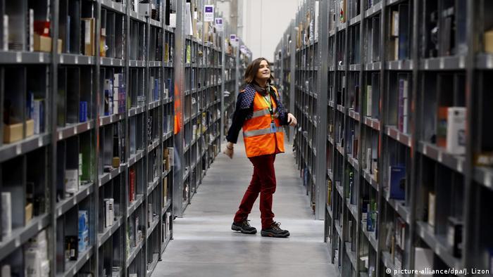 Amazon raises US minimum hourly wage to $15, as German union calls