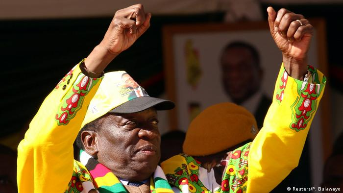 President Emmerson Mnangagwa greets supporters