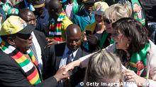 President Mnangagwa shakes hands with a white voter after a campaign address to white farmers and business owners.