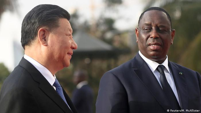 Xi and Sall face each other (Reuters/M. McAllister)