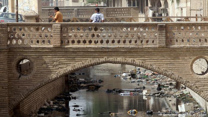 Fetid sewage polluting a canal in Basra, Iraq