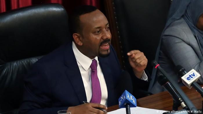 Ethiopia's Prime Minister Abiy Ahmed speaks into a microphone