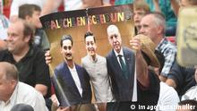 A poster of the photograph of Turkish President Erdogan and Mesut Özil with the words wrong decision in German (Imago/Horstmüller)
