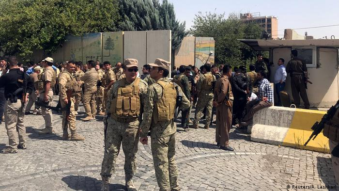 Security forces gather near the governorate building in Irbil