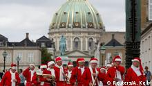 People dressed as Santa Claus meet at Amalienborg Castle as they take part in the World Santa Claus Congress, an annual event held every summer in Copenhagen, Denmark, July 23, 2018. REUTERS/Andrew Kelly