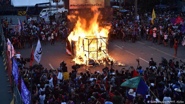 Philippine protesters burn effigy