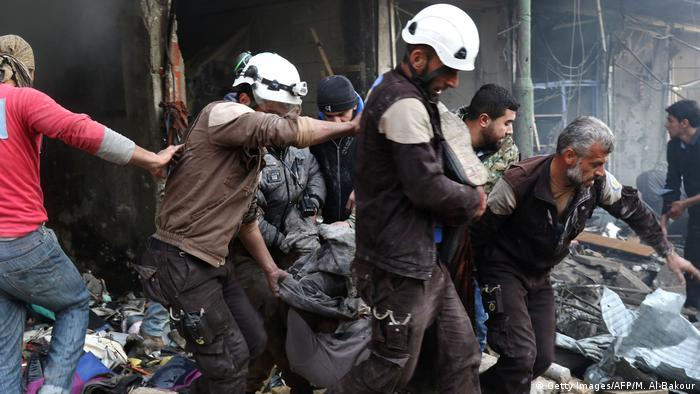 Members of the White Helmets participating in a rescue operation in Idlib, Syria after an airstrike.