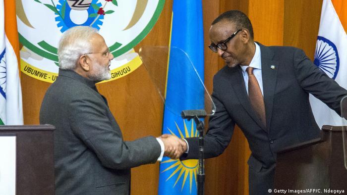 Indian Prime Minister Narendra Modi shakes hands with Rwanda's President Paul Kagame