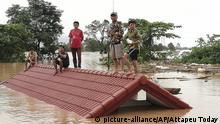 Villagers take refuge on a rooftop above flood waters from a collapsed dam in the Attapeu district of southeastern Laos, Tuesday, July 24, 2018. The official Lao news agency KPL reported Tuesday that the Xepian-Xe Nam Noy hydropower dam in Attapeu province collapsed Monday evening, releasing large amounts of water that swept away houses and made more than 6,600 people homeless. (Attapeu Today via AP) |