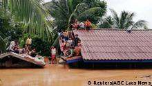 Villagers evacuate after the Xepian-Xe Nam Noy hydropower dam collapsed in Attapeu province, Laos July 24, 2018. ABC Laos News/Handout via REUTERS THIS IMAGE HAS BEEN SUPPLIED BY A THIRD PARTY.