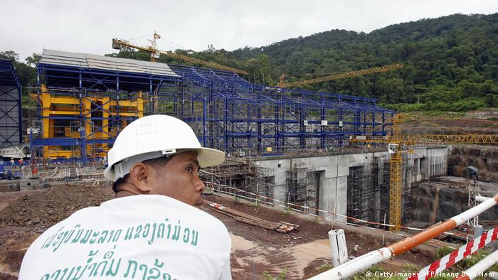 A worker at the Nam Theun 2 hydroelectric power plant in Laos (Getty Images/AFP/Hoang Dinh Nam)