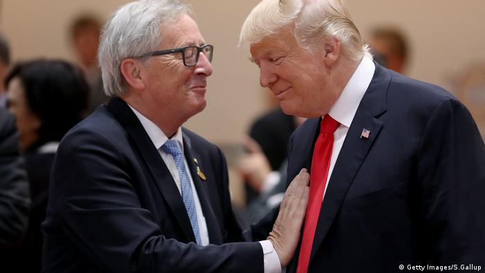 US President Donald Trump (R) and President of the European Commission Jean-Claude Juncker