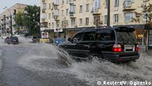 Cars pass through puddles during heavy rain in Kiev, Ukraine July 25, 2018. REUTERS/Valentyn Ogirenko