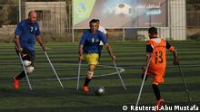 Members of a Palestinian amputee football team, which is made up of players most of who lost their legs in the conflict with Israel, play a game on a soccer pitch in the central Gaza Strip June 21, 2018. Picture taken June 21, 2018. REUTERS/Ibraheem Abu Mustafa