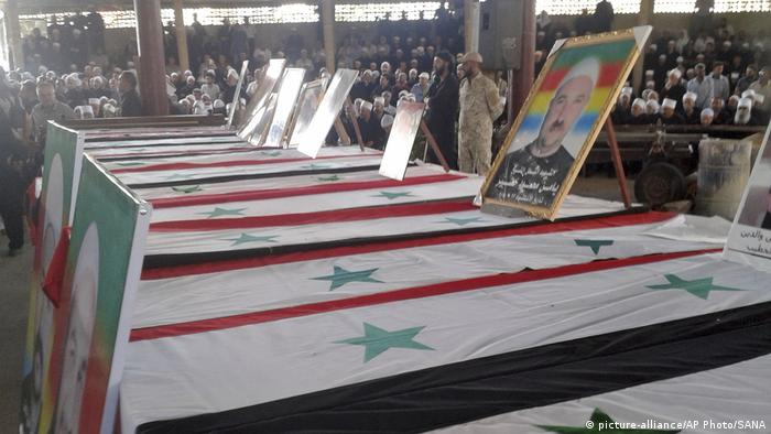 Coffins for victims of the bombing in Suwayda city, Syria