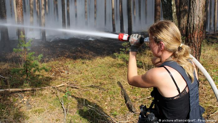A firefighter works to contain the wildfire in Potsdam