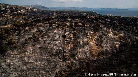 Aerial shot of burnt area following wildfire in Greece