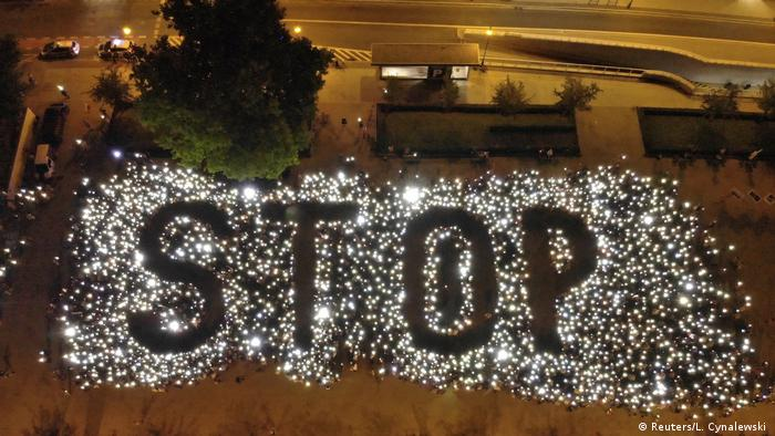demonstrators used lights to spell out the word 'stop