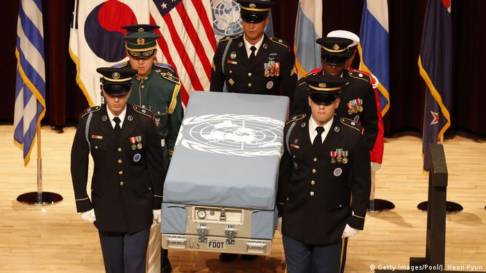 Soldiers carry the remains of a Korean War Solider across a stage (Getty Images/Pool/J. Heon-Kyun)