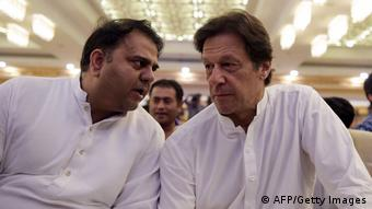 Pakistan's information minister Fawad Chaudhry with PM Imran Khan (AFP/Getty Images)