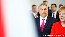 05,07,2018 *** German Chancellor Angela Merkel and Hungarian Prime Minister Viktor Orban arrive talk to the media after a meeting in Berlin, Germany, July 5, 2018. REUTERS/Axel Schmidt