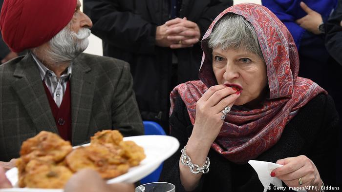 Theresa May sampling a samosa
