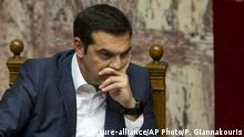 05.07.2018 Greek Prime Minister Alexis Tsipras, attends a parliamentary session as Party leaders debate on the economy and the Eurogroup's recent decisions on Greek debt, in Athens, on Thursday, July 5, 2018. (AP Photo/Petros Giannakouris) |
