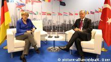 BRUSSELS, BELGIUM - JULY 11: Turkish President Recep Tayyip Erdogan (R) meets with German Chancellor Angela Merkel (L) within the 2018 NATO Summit on July 11, 2018 in Brussels, Belgium. Kayhan Ozer / Anadolu Agency | Keine Weitergabe an Wiederverkäufer.