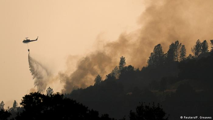 Helicopters dropped water on hotspots in the hills west of Redding