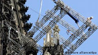 Scaffolding surrounds a spire of the cathedral during restoration work