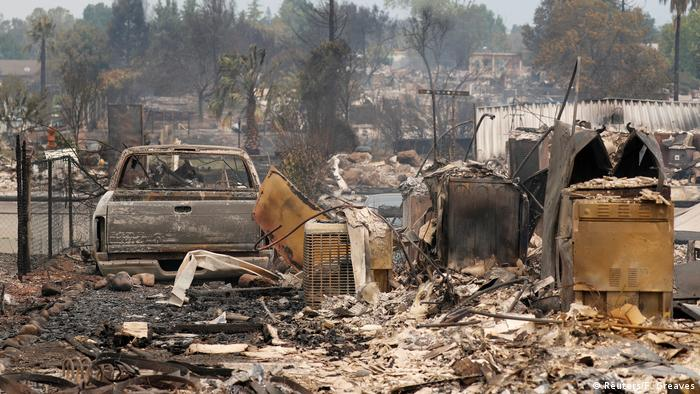The fire left houses and vehicles burned out west of Redding