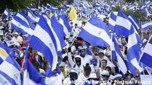 28.07.2018 Nicaraguans hold national flags demanding the resignation of President Daniel Ortega and the release of all political prisoners during a march in support of the Catholic church amid recent attacks by pro-government groups, in Managua, Nicaragua, Saturday, July 28, 2018. At least 448 people have been killed, most of them protesters, since the protests began in April. Demonstrators were initially upset over proposed social security cuts but are now demanding Ortega leave office after a deadly crackdown by security forces and armed pro-government civilians. (AP Photo/Arnulfo Franco)  