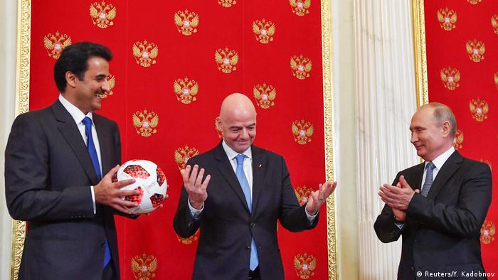 Qatar Emir Shaikh Tamin bin Hamad al-Thani, FIFA President Gianni Infantino and Russian President Vladimir Putin at a World Cup handover ceremony for the 2022 World Cup at the Kremlin (Reuters/Y. Kadobnov)