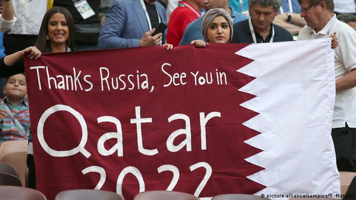 World Cup fan banner reads: Thanks Russia see you in Qatar 2022