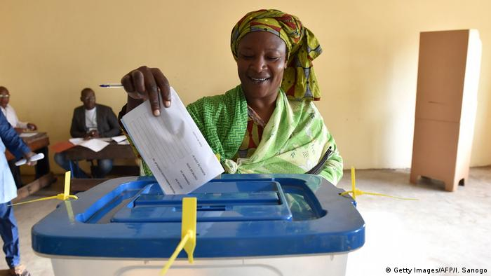 A woman casts her ballot in Mali's presidential election