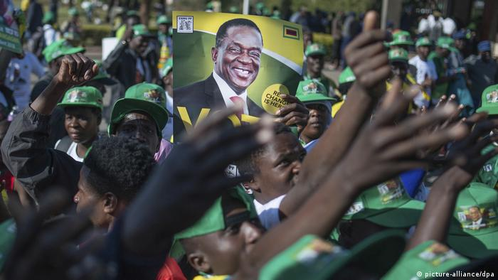 Supporters of ruling ZANU-PF candidate Emmerson Mnangagwa at an election rally