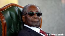 Zimbabwe's former president Robert Mugabe looks on during a press conference at his private residence nicknamed Blue Roof in Harare