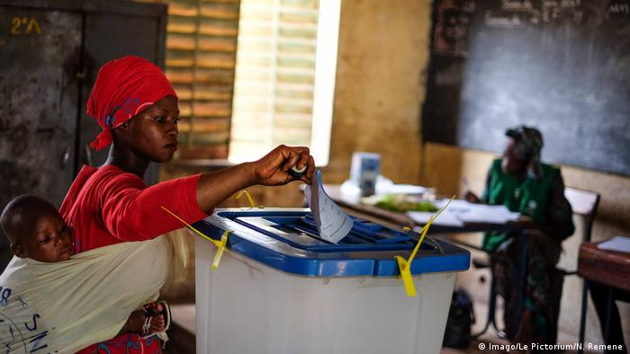 A woman votes in Mali; only one of the 24 candidates is a woman