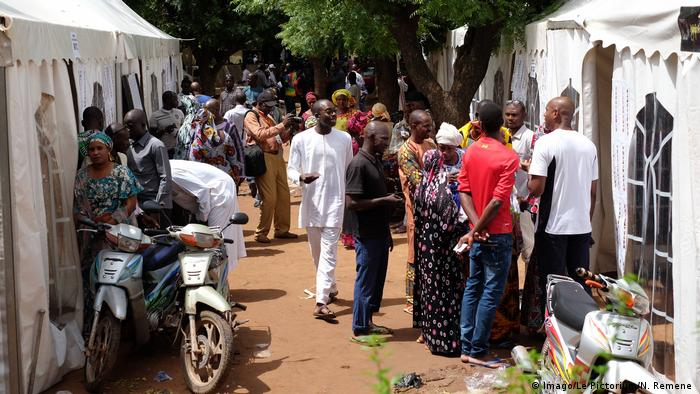 Voters at the Mali polling station where President Ibrahim Boubacar Keita voted