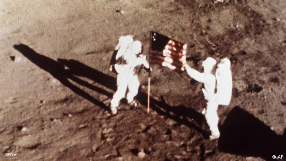 Astronauts planting flag on the moon